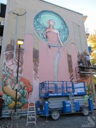 notre dame de grace graffiti mural by a shop an error occurred
