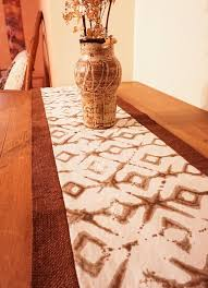 step up your global decor with a burlap table runner tribal decor