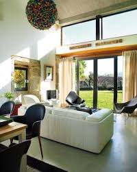 glass wall design for living room interior natural lighting in the modern lounge room with glass