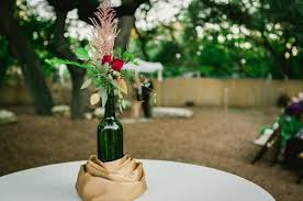 wine bottle wedding centerpieces empty glass bottles fill in as gorgeous wedding centerpieces