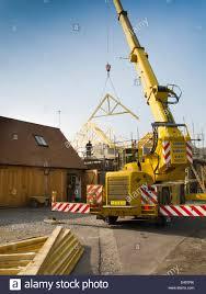 crane lifting timber stock photos u0026 crane lifting timber stock