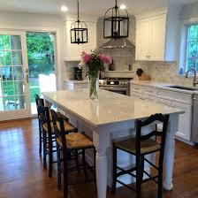 open concept kitchen and dining room white cabinets and lg
