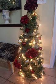 inexpensive trees made of garland and tomato cages for the urns
