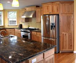 glass countertops rustic hickory kitchen cabinets lighting
