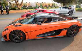 koenigsegg agera s veneno owner kris singh takes delivery of first u s spec