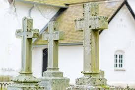 church crosses three christian crosses on grave yard white church