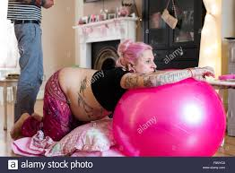 Home Birth by Woman Leaning On A Yoga Ball During Labour In An Unassisted Home