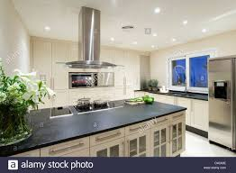 Kitchen Island Worktop by Chrome Extractor Above Hob In Island Unit With Black Granite
