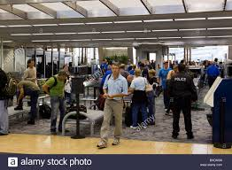 travelers stock images Travelers pass through airport security checkpoint tsa tampa jpg