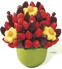 eatables arrangements chocolate covered apple slices pineapple cantalope