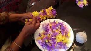 making an indian flower garland gajra with flowers one of the