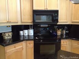painting the kitchen cabinets pinterest addict black appliances copper door pulls