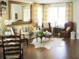 Cowhide Rug In Living Room A Stroll Thru Life How To Use A Cowhide Rug Tips