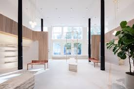 striated concrete partitions create fitting rooms at thakoon u0027s