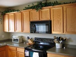 top of kitchen cabinet decor ideas space above kitchen cabinet decorating ideas home design ideas