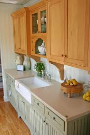 how to paint stained kitchen cabinets these green cabinets with this countertop stained