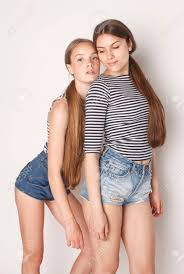cute teenagers two cute teenagers having fun together isolated on white girls