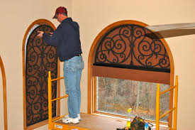 window treatment design idea for arched window with faux iron