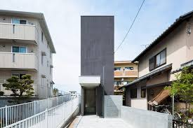 urban home design narrow urban home with concrete walls and upper bridge