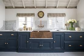 blue kitchen cabinets with copper hardware the copper sink and blue cabinetry create stunning