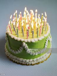 happy birthday candles on a birthday cake stock photo getty images