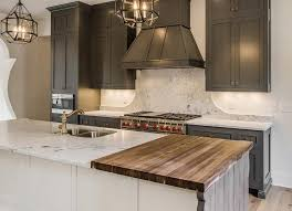 kitchen island chopping block a white kitchen island is fitted with a drop butcher block