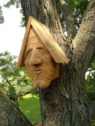 carved cedar wood sculpture by sculptor david gross titled