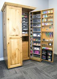 scrapbooking cabinets and workstations scrapbook armoire turned into a sewing cabinet with fold up table