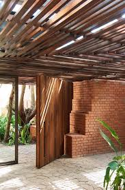 wooden ceiling at brick kiln house design in small village