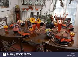 halloween flowers halloween kitchen table table covered wood table plates black