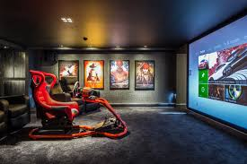 majik house transforms basement into cinema and gaming room