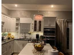 how to install cabinets with uneven ceiling uneven ceiling height how to hang lighting