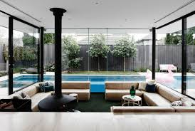 a sunken lounge room surrounded by a pool is the centerpiece of