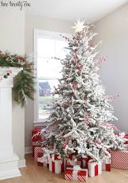 flocked christmas tree and white flocked christmas tree