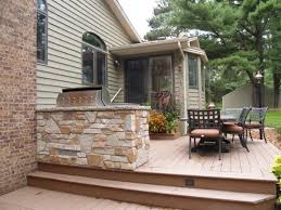 comfortable deck with black iron furniture set and small prefab