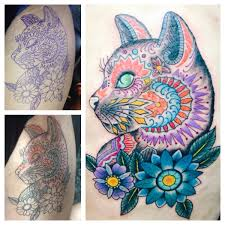 my louis wain inspired cat memorial tat done by sole del real