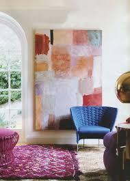artistic painting on plain wall closed unusual glass window inside