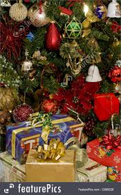 presents under decorated tree picture