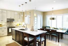 kitchen island with pendant lights pendant lights above kitchen island hung at different heights to