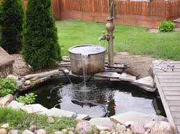 Water Feature Ideas For Small Backyards Pond Fountain Have Also Turned An Antique Water Pump Into A