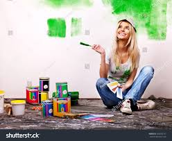happy woman paint wall home stock photo 163593197 shutterstock