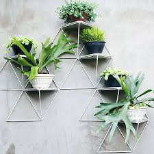 these geometric shelves turn your plants into a chic art