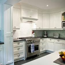 backsplash ideas for white cabinets and black countertops white granite countertops transitional kitchen deslaurier