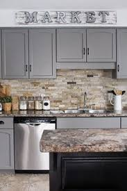 How To Paint Oak Cabinets by From To Great A Tale Of Painting Oak Cabinets