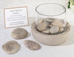 guestbook idea sign stones and add them into a vase