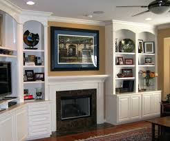 transforming a fireplace and built in bookcases love the stone