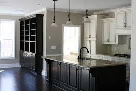 a beautiful kitchen with contrasting finishes i the