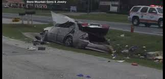 dramatic video shows out of control car crash good samaritans