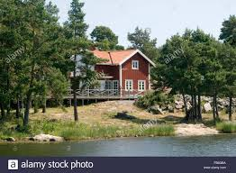 red swedish house on lake water falun paint rural countryside