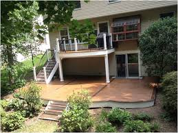 creating an outdoor deck design above a walkout patio amazing